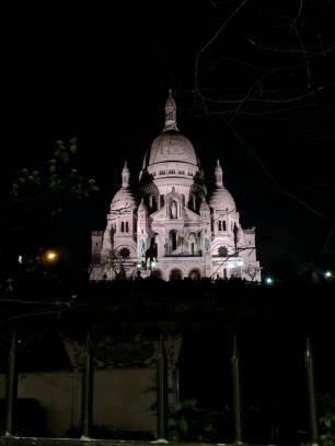 View of Sacre Coeur from the street at night